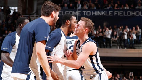 Feb 2, 2019; Indianapolis, IN, USA; Butler Bulldogs guard Paul Jorgensen (5) is congratulated by his teammates after making a three point shot against the Seton Hall Pirates during the first half at Hinkle Fieldhouse. Mandatory Credit: Brian Spurlock-USA TODAY Sports