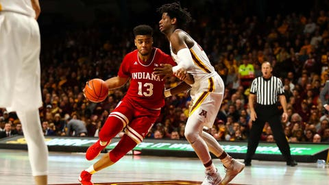 Feb 16, 2019; Minneapolis, MN, USA; Indiana Hoosiers forward Juwan Morgan (13) drives to the basket while Minnesota Golden Gophers center Daniel Oturu (25) defends in the second half at Williams Arena. The Minnesota Golden Gophers defeatd the Indiana Hoosiers 84-63. Mandatory Credit: David Berding-USA TODAY Sports