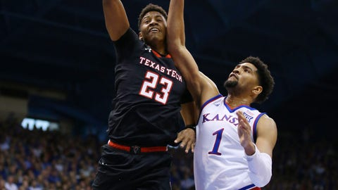 Feb 2, 2019; Lawrence, KS, USA; Texas Tech Red Raiders guard Jarrett Culver (23) is called for an offensive foul as Kansas Jayhawks guard Ochai Agbaji (30) and forward Dedric Lawson (1) defend in the first half at Allen Fieldhouse. Mandatory Credit: Jay Biggerstaff-USA TODAY Sports