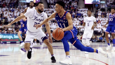 Feb 11, 2019; Fort Worth, TX, USA; Kansas Jayhawks guard Devon Dotson (11) drives to the basket as TCU Horned Frogs guard Alex Robinson (25) defends during the second half at Ed and Rae Schollmaier Arena. Mandatory Credit: Kevin Jairaj-USA TODAY Sports