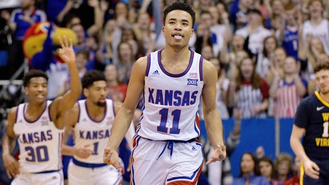 Feb 16, 2019; Lawrence, KS, USA; Kansas Jayhawks guard Devon Dotson (11) celebrates after scoring a three point shot during the first half against the West Virginia Mountaineers at Allen Fieldhouse. Mandatory Credit: Denny Medley-USA TODAY Sports
