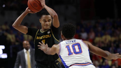 Feb 23, 2019; Gainesville, FL, USA;Missouri Tigers guard Xavier Pinson (1) drives to the basket as Florida Gators guard Noah Locke (10) defends during the first half at Exactech Arena. Mandatory Credit: Kim Klement-USA TODAY Sports