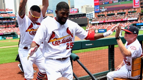 Jul 15, 2018; St. Louis, MO, USA; St. Louis Cardinals right fielder Dexter Fowler (25) is congratulated by second baseman Kolten Wong (16) and interim manager Mike Shildt (83) after hitting a solo home run off of Cincinnati Reds starting pitcher Anthony DeSclafani (not pictured) during the second inning at Busch Stadium. Mandatory Credit: Jeff Curry-USA TODAY Sports