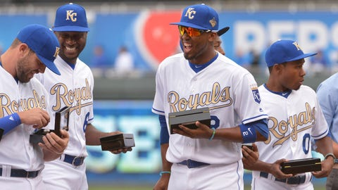 Apr 5, 2016; Kansas City, MO, USA; Kansas City Royals third baseman Mike Moustakas (8), center fielder Lorenzo Cain (6), and shortstop Alcides Escobar (2) laugh as they view their World Series rings prior to the game against the New York Mets at Kauffman Stadium. The Mets won 2-0. Mandatory Credit: Denny Medley-USA TODAY Sports