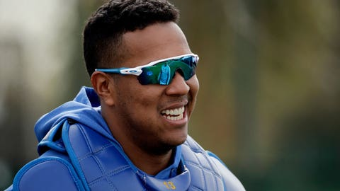 Kansas City Royals catcher Salvador Perez talks with teammates during spring training baseball practice Wednesday, Feb. 13, 2019, in Surprise, Ariz. (AP Photo/Charlie Riedel)