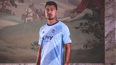 Sporting Kansas City midfielder Roger Espinoza models the club's new 2019 kit.