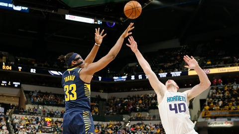 Feb 11, 2019; Indianapolis, IN, USA; Indiana Pacers center Myles Turner (33) takes a shot against Charlotte Hornets center Cody Zeller (40) during the fourth quarter at Bankers Life Fieldhouse. Mandatory Credit: Brian Spurlock-USA TODAY Sports