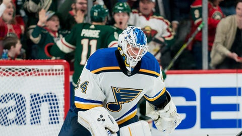 Feb 24, 2019; Saint Paul, MN, USA; St Louis Blues goalie Jake Allen (34) skates to the bench in overtime after allowing a goal to Minnesota Wild forward Ryan Donato (6) at Xcel Energy Center. Mandatory Credit: Brad Rempel-USA TODAY Sports