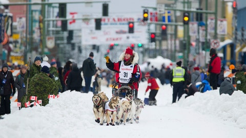 <p>               File - In this March 3, 2018, file photo, musher Aliy Zirkle runs her team during the ceremonial start of the Iditarod Trail Sled Dog Race in Anchorage, Alaska. The veteran musher is leading in Alaska's Iditarod Trail Sled Dog Race. She is seeking to become the first woman to win in nearly three decades. She was first to leave the Ophir checkpoint Wednesday, March 6, 2019, 432 miles into the race. (AP Photo/Michael Dinneen, File)             </p>