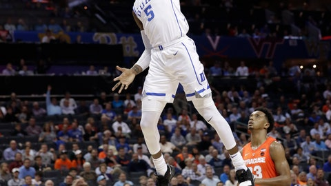 <p>               Duke's RJ Barrett (5) goes up to dunk against Syracuse's Frank Howard (23) during the second half of an NCAA college basketball game in the Atlantic Coast Conference tournament in Charlotte, N.C., Thursday, March 14, 2019. (AP Photo/Chuck Burton)             </p>