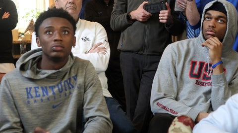 <p>               Kentucky's Ashton Hagans, coach John Calipari, left rear, and PJ Washington, right, watch the broadcast of the NCAA men's Division I college basketball tournament selection show at Calipari's home in Lexington, Ky., Sunday, March 17, 2019. (AP Photo/James Crisp)             </p>