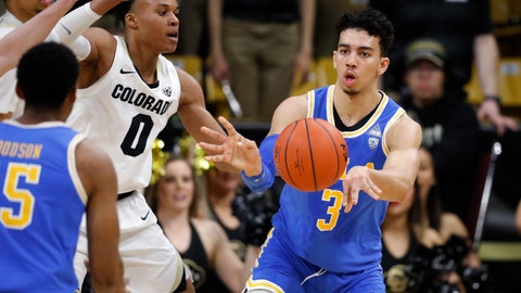<p>               UCLA guard Jules Bernard, back right, passes the ball to guard Armani Dodson, front, as Colorado guard Shane Gatling defends in the second half of an NCAA college basketball game Thursday, March 7, 2019, in Boulder, Colo.(AP Photo/David Zalubowski)             </p>