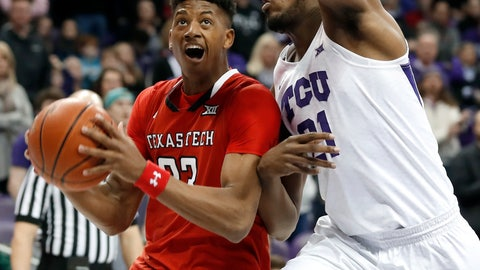 <p>               Texas Tech guard Jarrett Culver (23) works against TCU center Kevin Samuel (21) for a shot in the first half of an NCAA college basketball game in Fort Worth, Texas, Saturday, March 2, 2019. (AP Photo/Tony Gutierrez)             </p>