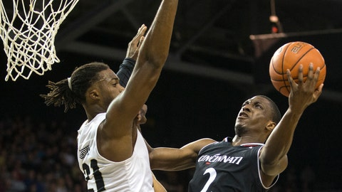<p>               Cincinnati guard Keith Williams (2) tries to shoot over Central Florida forward Chad Brown (21) during the first half of an NCAA college basketball game, Thursday, March 7, 2019, in Orlando, Fla. (AP Photo/Willie J. Allen Jr.)             </p>