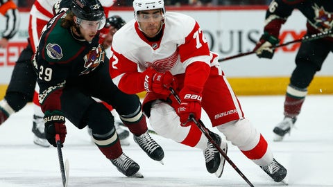 <p>               Detroit Red Wings center Andreas Athanasiou (72) skates with the puck in front of Arizona Coyotes right wing Mario Kempe (29) during the first period of an NHL hockey game Saturday, March 2, 2019, in Glendale, Ariz. (AP Photo/Ross D. Franklin)             </p>