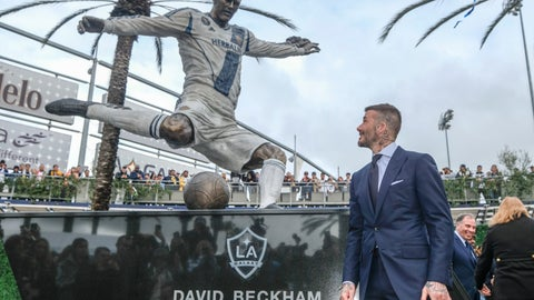 <p>               Former LA Galaxy MLS soccer midfielder David Beckham looks at a statue of himself at Legends Plaza in front of Dignity Health Sports Park in Carson, Calif., Saturday, March 2, 2019. (AP Photo/Ringo H.W. Chiu)             </p>