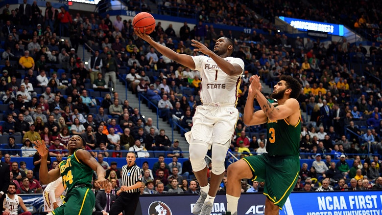 FSU withstands a 3-point barrage to hold off Vermont in 1st round of NCAA Tournament