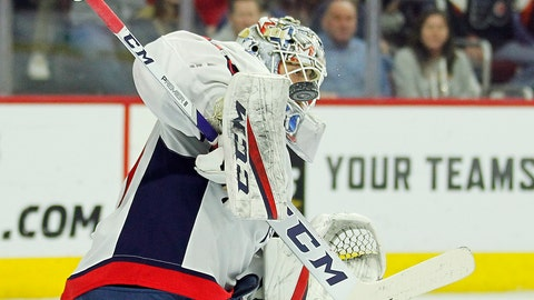 <p>               Washington Capitals' Braden Holtby deflects the puck with his board during the second period of an NHL hockey game against the Philadelphia Flyers, Wednesday, March 6, 2019, in Philadelphia. The Capitals won 5-3. (AP Photo/Tom Mihalek)             </p>