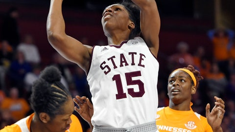 <p>               Mississippi State's Teaira McCowan (15) shoots over Tennessee's Zaay Green, left, and Cheridene Green during the first half of an NCAA college basketball game at the Southeastern Conference women's tournament, Friday, March 8, 2019, in Greenville, S.C. (AP Photo/Richard Shiro)             </p>