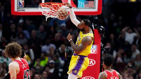 <p>               Los Angeles Lakers forward LeBron James (23) dunks in front of Chicago Bulls guard Antonio Blakeney (9) during the second half of an NBA basketball game Tuesday, March 12, 2019, in Chicago. (AP Photo/Nuccio DiNuzzo)             </p>