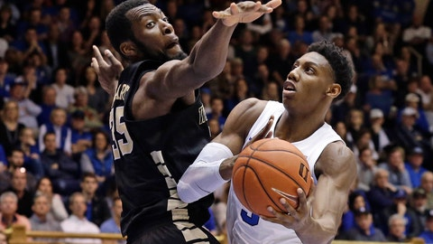 <p>               Duke's RJ Barrett (5) drives to the basket against Wake Forest's Ikenna Smart (35) during the second half of an NCAA college basketball game in Durham, N.C., Tuesday, March 5, 2019. Duke won 71-70. (AP Photo/Gerry Broome)             </p>