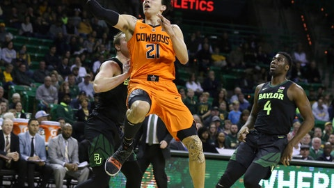 <p>               Oklahoma State guard Lindy Waters III, center, scores between Baylor guard Makai Mason, left, and guard Mario Kegler, right, in the first half of an NCAA college basketball game, Wednesday, March 6, 2019, in Waco, Texas. (Rod Aydelotte/Waco Tribune Herald, via AP)             </p>