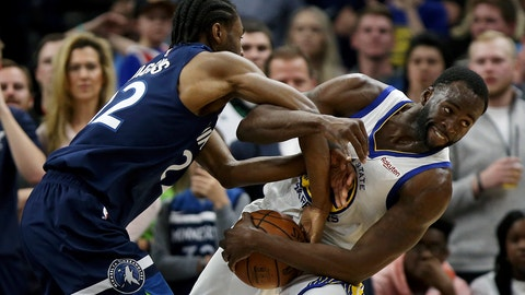 <p>               Golden State Warriors' Draymond Green fights for possession of the ball against Minnesota Timberwolves' Andrew Wiggins during the second half of an NBA basketball game Friday March 29, 2019, in Minneapolis. Minnesota won 131-130 in overtime. (AP Photo/Stacy Bengs)             </p>