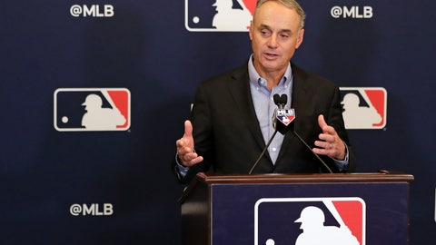 <p>               FILE - In this Feb. 8, 2019 file photo, Rob Manfred, commissioner of Major League Baseball, speaks during a news conference at owners meetings in Orlando, Fla. Major League Baseball and Reds are this season commemorating the 150th anniversary of the Cincinnati Red Stockings, who pioneered professional baseball.  Manfred will be grand marshal Thursday, March 28 of the 100th Findlay Market Opening Day Parade in Cincinnati. The colorful parade featuring floats, marching bands and celebrities will begin winding through the city.  (AP Photo/John Raoux, File)             </p>