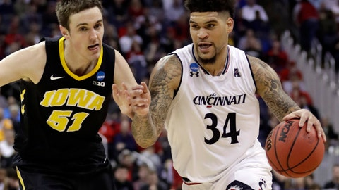 <p>               Cincinnati's Jarron Cumberland (34) drives past Iowa's Nicholas Baer (51) in the first half during a first round men's college basketball game in the NCAA Tournament in Columbus, Ohio, Friday, March 22, 2019. (AP Photo/Tony Dejak)             </p>