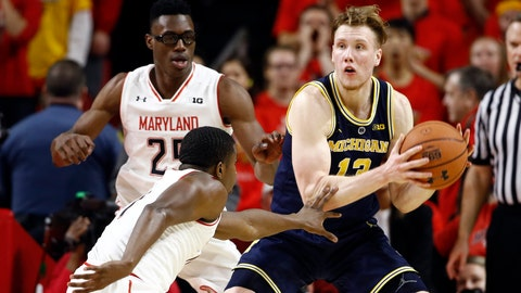 <p>               Michigan forward Ignas Brazdeikis, right, of Canada, protects the ball as he is pressured by Maryland forward Jalen Smith, left, and guard Darryl Morsell in the second half of an NCAA college basketball game, Sunday, March 3, 2019, in College Park, Md. (AP Photo/Patrick Semansky)             </p>