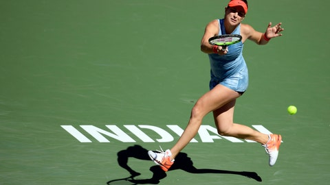 <p>               Belinda Bencic, of Switzerland, returns a shot to Karolina Pliskova, of the Czech Republic, at the BNP Paribas Open tennis tournament Thursday, March 14, 2019, in Indian Wells, Calif. (AP Photo/Mark J. Terrill)             </p>