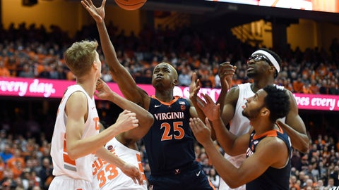 <p>               Virginia forward Mamadi Diakite (25) reaches for a rebound during the first half of an NCAA college basketball game against Syracuse in Syracuse, N.Y., Monday, March 4, 2019. (AP Photo/Adrian Kraus)             </p>