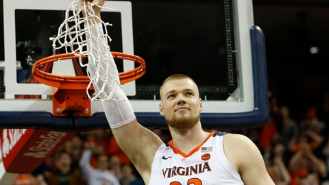 <p>               Virginia center Jack Salt (33) holds the net after a victory over Louisville after an NCAA college basketball game in Charlottesville, Va., Saturday, March 9, 2019. (AP Photo/Steve Helber)             </p>