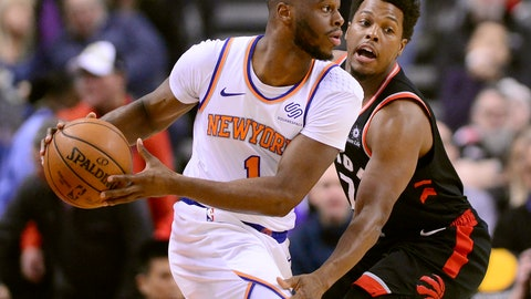 <p>               New York Knicks guard Emmanuel Mudiay (1) looks to move the ball as Toronto Raptors guard Kyle Lowry (7) defends during first-half NBA basketball game action in Toronto, Monday, March 18, 2019. (Frank Gunn/The Canadian Press via AP)             </p>
