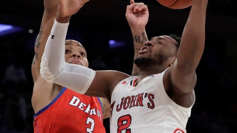 <p>               St. John's guard Shamorie Ponds (2) goes up for a shot against DePaul guard Devin Gage (3) during the first half of an NCAA college basketball game in the Big East men's tournament, Wednesday, March 13, 2019, in New York. (AP Photo/Julio Cortez)             </p>