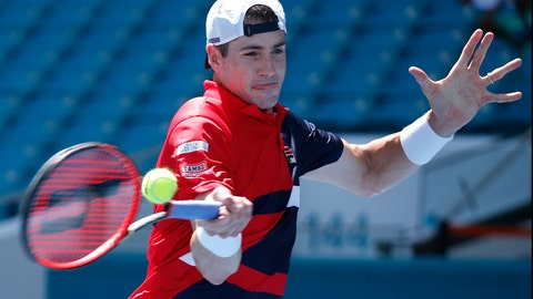 <p>               John Isner, returns a volley to Kyle Edmund, of the United Kingdom, during the Miami Open tennis tournament, Tuesday, March 26, 2019, in Miami Gardens, Fla. (AP Photo/Joel Auerbach)             </p>