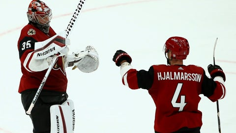 <p>               Arizona Coyotes goaltender Darcy Kuemper (35) celebrates his shutout against the Calgary Flames with defenseman Niklas Hjalmarsson (4) at the end of an NHL hockey game Thursday, March 7, 2019, in Glendale, Ariz. The Coyotes won 2-0. (AP Photo/Ross D. Franklin)             </p>