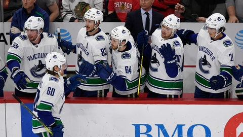 <p>               Vancouver Canucks' Markus Granlund (60), of Finland, celebrates with teammates on the bench after scoring a goal during the second period of an NHL hockey game against the Chicago Blackhawks, Monday, March 18, 2019, in Chicago. (AP Photo/Paul Beaty)             </p>