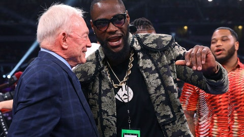 <p>               Dallas Cowboys owner Jerry Jones talks with boxer Deontay Wilder before the IBF welterweight championship boxing bout between Errol Spence Jr. and Mikey Garcia on Saturday, March 16, 2019, in Arlington, Texas. (AP Photo/Richard W. Rodriguez)             </p>