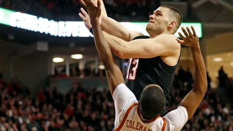 <p>               Texas Tech's Matt Mooney (13) shoots over Texas' Matt Coleman III (2) during the first half of an NCAA college basketball game Monday, March 4, 2019, in Lubbock, Texas. (AP Photo/Brad Tollefson)             </p>