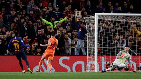 <p>               Barcelona forward Ousmane Dembele, left, scores his side's fifth goal during the Champions League round of 16, 2nd leg, soccer match between FC Barcelona and Olympique Lyon at the Camp Nou stadium in Barcelona, Spain, Wednesday, March 13, 2019. (AP Photo/Manu Fernandez)             </p>