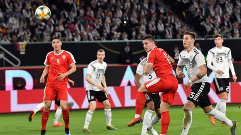 <p>               Serbia's Luka Jovic, third right, scores his side's opening goal during a international friendly soccer match between Germany and Serbia at the Volkswagen Arena stadium in Wolfsburg, Germany, Wednesday, March 20, 2019. (AP Photo/Martin Meissner)             </p>