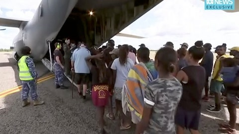 <p>               In this image made from video taken on March 21, 2019, storm evacuees board an Australian Defence Force C-130 plane preparing to take off from Borroloola, Australia. Two powerful cyclones are spinning toward Australia's sparsely populated north where around 2,000 people have been evacuated from the east coast of the Northern Territory ahead of strong winds, mountainous waves and flooding rain. (Australian Broadcasting Corporation via AP)             </p>