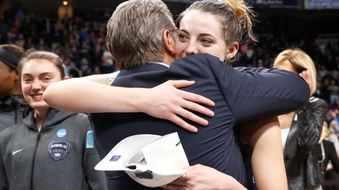 <p>               Connecticut head coach Geno Auriemma, front left, and top scorer Connecticut guard Katie Lou Samuelson embrace after defeating Louisville in a regional championship final in the NCAA women's college basketball tournament, Sunday, March 31, 2019, in Albany, N.Y. (AP Photo/Kathy Willens)             </p>