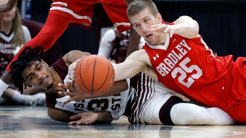 <p>               Bradley's Nate Kennell (25) and Missouri State's Tulio Da Silva dive after a loose ball during the second half of an NCAA college basketball game in the quarterfinal round of the Missouri Valley Conference tournament, Friday, March 8, 2019, in St. Louis. Bradley won 61-58. (AP Photo/Jeff Roberson)             </p>