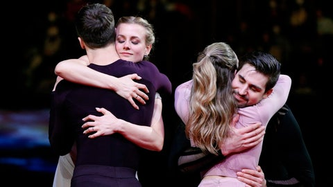 <p>               Gabriella Papadakis and Guillaume Cizeron of France, back to camera, hug Madison Hubbell and Zachary Donohue of the U.S. during the medal ceremony for the ice dance free dance during the ISU World Figure Skating Championships at Saitama Super Arena in Saitama, north of Tokyo, Saturday, March 23, 2019. (AP Photo/Andy Wong)             </p>
