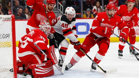 <p>               Detroit Red Wings goaltender Jimmy Howard (35) stops a shot by New Jersey Devils right wing Joey Anderson (49) during the third period of an NHL hockey game Friday, March 29, 2019, in Detroit. (AP Photo/Paul Sancya)             </p>