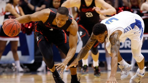 <p>               Northeastern's Shawn Occeus, left, drives down the court against Hofstra's Justin Wright-Foreman in the first half of an NCAA college basketball game at the Colonial Athletic Association men's basketball championship, Tuesday, March 12, 2019, in North Charleston, S.C. (AP Photo/Mic Smith)             </p>