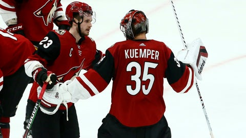 <p>               Arizona Coyotes goaltender Darcy Kuemper (35) celebrates his shutout against the Chicago Blackhawks with Coyotes defenseman Oliver Ekman-Larsson (23) as time expires the third period of an NHL hockey game Tuesday, March 26, 2019, in Glendale, Ariz. The Coyotes defeated the Blackhawks 1-0. (AP Photo/Ross D. Franklin)             </p>