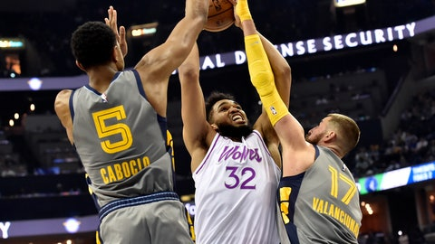 <p>               Minnesota Timberwolves center Karl-Anthony Towns (32) shoots against Memphis Grizzlies center Jonas Valanciunas (17) and forward Bruno Caboclo (5) in the second half of an NBA basketball game Saturday, March 23, 2019, in Memphis, Tenn. (AP Photo/Brandon Dill)             </p>